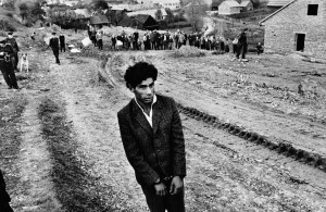 Koudelka - Reconstruction of a homicide. In the foreground-a young gypsy suspected of being guilty. Jarabina, Czechoslovakia, 1963